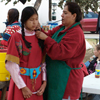 Crow Woman Braiding Girls Hair For Parade: 1_099