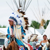 Young Boy In Eagle Feather Headdress in Crow Fair Parade: 1_140